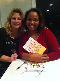 Book signing at launch party.
