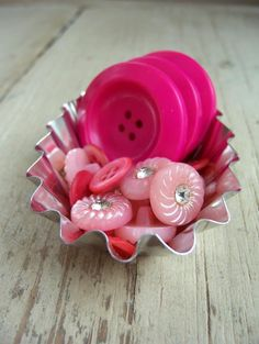 pretty pink buttons look great in the tart tin, would add a great accent to a stitchery display