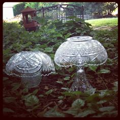 cheap florist vases with dollar store bowls on top... glass mushrooms for the garden!