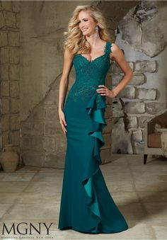 Evening Gowns and Mother of the Bride Dresses by MGNY Beaded Appliques Combined with Chantilly Lace on Crepe Matching Stole. Available in Black, Teal