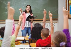 Teacher asking her students a question at the elementary school