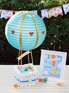 Pin for Later: It's Not a Baby Shower Without a Diaper Cake! Hot Air Balloon Diaper Cake How sweet is this hot air balloon diaper cake? It looks ready to fly away! Source: Hostess with the Mostess Diy Diapers, Baby Shower Diapers, Baby Boy Shower, Baby Shower Gifts, Baby Gifts, Diaper Cakes Tutorial, Diy Diaper Cake, Cake Tutorial, Nappy Cake