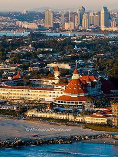 Great view of downtown SD from Coronado Island. I can't wait to be in Cali and be at this beach! I hear the sand sparkles! I can't wait to see this famous hotel and be at the Ocean :)  not staying at this hotel but wish I was lol...  looks like the hyatt is in the background though :)