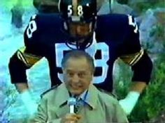 Myron Cope standing in front of Jack Lambert. I never realized Myron was that tall.