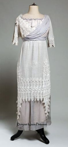 Dress, Gjuro Matić, Zagreb, circa. 1912. One piece. Tunic of tulle with tiny polka dots & embossed lace tulle over blue voile skirt. Museum of Arts & Crafts, Zagreb, via AthenaPlus