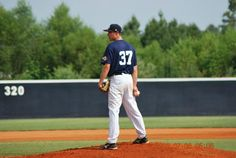 Christopher Baldi throwing a pitch at the Perfect Game Showcase in East, Cobb Georgia July 2012.