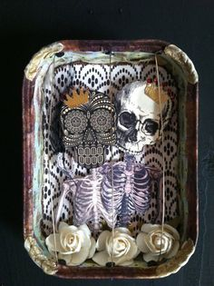 sardine tin shrine...I wouldn't do anything Halloween but something as a rememberence piece....CUTE idea