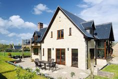 Local Stone Use locally sourced materials (as the locals would have done for hundreds of years before) and your new home definitely won't stick out like a sore thumb. This home in Dorset is constructed from thermal blockwork and faced with local Marnhull stone. See more: http://www.homebuilding.co.uk/completedprojects/a-stone-home-in-dorset