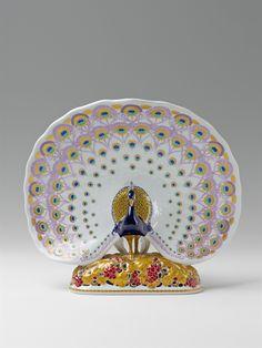 Königliche Porzellanmanufaktur Berlin, 1913/14. Designed by Wilhelm Carl Robra in 1912.A Berlin KPM porcelain model of a peacock, Auction 1065 The Berlin Sale, Lot 62 #KPM #porcelain #porzellan #koeniglicheporzellanmanufaktur #peacock #pfau