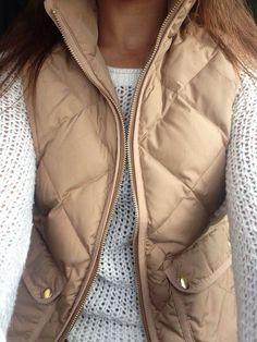 Tan vest & cream sweater.