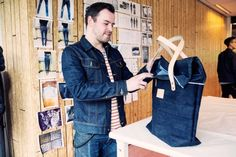 Mike van der Zanden shows a bag from his collection Dyemond Goods. His jacket is Lee, shirt is Scotch & Soda, jeans are Edwin.