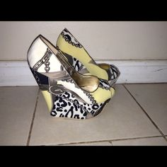 Chain/leopard print wedges Peep toe Yellow/black chain print. Worn once. Fits 8-8.5 Shoes Wedges