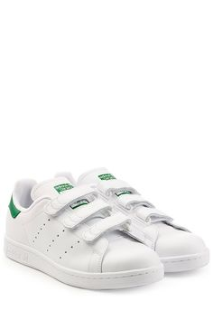 Add a touch of urban prep to casual looks with Adidas Originals\u0027 iconic  leather Stan Smith sneakers. This bright white pair are finished with easy  Velcro ...