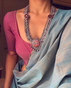 Blue saree with pink blouse and oxidized silver necklace silver design Blue saree Pink blouseOxidised silver necklace Saree Jacket Designs, Saree Blouse Neck Designs, Saree Blouse Patterns, Trendy Sarees, Stylish Sarees, Dress Indian Style, Indian Dresses, Indian Clothes, Indian Wear