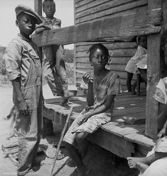 Children on the Mississippi Delta African American children are shown around a porch of a home in the Mississippi Delta. Date: July, 1936 Original Format: Photographic Print Item Photographer: Dorothea Lange Delta Children, American Children, Poor Children, Poor Kids, Black History Facts, Black History Month, Old Pictures, Old Photos, Antique Photos