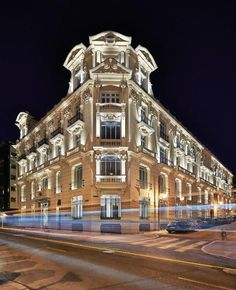 The URSO occupies an opulent, early 20th-century palatial building. The architect, Antonio Obrador, has conserved many original features, such as the tiles on the façade, the fabulous mahogany lift and the stained-glass windows on the staircase. Although it is in the centre of Madrid, a muted palette of cool green, grey and cream tones and delicate Japanese prints create an air of calm and discreet chicness. Japanese Prints, Hotel Spa, Stained Glass Windows, Facade, Madrid, Centre, Tiles, Spain, Palette