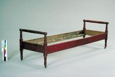 Turn a boring twin bed frame into an attractive daybed.