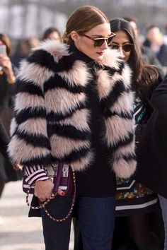 Olivia Palermo wearing pink fur with black stripes. See more at www.herstyledview.com
