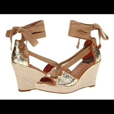 1 HR SALESperry GoldGlitter Ankle Milly Wedges Summer gold glitter wedges from Milly for Sperry Top Sider. Ties at the ankle. 3 3/4 in height. Letter M charm on the ties. Leather and cotton upper. Has wave sipping technology to provide traction in wet and dry environments. No box. (I left it back home, but if I find it will include) Sperry Top-Sider Shoes
