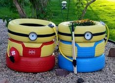 Minion with unused tyres for garden decoration.