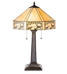 Our Dorchester Tiffany Glass Table Lamp is enhanced with metal woodland cutouts around the skirt of the shade. The simple yet elegant design of this lamp includes 32 pieces of amber-colored glass embellished with a laser-cut leaf and forest animal design. The pebble-textured base resembles traditional cast bronze but is made of durable resin.