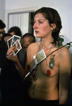 Marina Abramovic - Rhythm 0 (1974)    72 objects (including a gun and a bullet) were laid out on a table for the spectators to use on the artist in any way they chose to use them.
