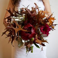 Going full-fleged fall theme?  Check out this edgy bouquet stuffed with lovely fall leaves!