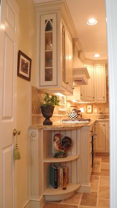 OMG.....looks like my kitchen (and rooster too) See how cute the Mackenzie Childs Courtly Check teapot looks