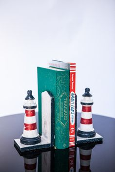 LIGHTHOUSE BOOKENDS - $29 Milly and Eugene's Timber, Lighthouse Bookends are hand carved and hand painted. They are available in two different colour combinations, navy, red and white or blue, pale green and white. Hand Carved, Hand Painted, Colour Combinations, Lighthouse, Different Colors, Fathers Day, Bookends, Mothers, Red And White