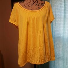 Yellow Model Lane Bryant Tee W/Cap Sleeves Yellow loose fit model tee. Cap sleeves and elastic waistband to give shape. Stich detailing around color and around the base of the sleeve. 60% cotton/40% model. Lightweight and great for summer. Never worn, washed once. In new condition. Lane Bryant Tops Tees - Short Sleeve