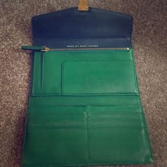 Marc by Marc Jacobs Green Wallet Marc by Marc Jacobs Leather Wallet in Emerald and Hunter Green with Gold Hardware Details. This wallet is in perfect condition other than a small stain on the gold clasp in front, willing to work with you on the price! Marc by Marc Jacobs Bags Wallets
