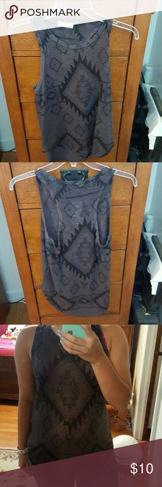 Cute Knitted Top!! Brand new. It has a knitted feel to it and slightly see through as seen in the picture. Very comfy material and has otherwise never been worn (was only worn for modeling purposes). Ginger G Tops