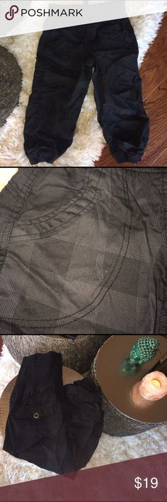 Cargo pants Black on black with square design below the knee cargo pants. Can wear them high waisted or folded down. Pockets in front and in back.  Draw string. Pants
