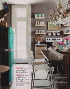 Grey kitchen walls. Chandelier in the kitchen! antique wood island.  Love