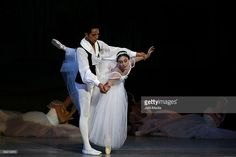 Ballet dancers Raul Fernandez and Sandra Barcenas of the national company of dance performs at the Esperanza Iris Teather on June 5, 2009 in Mexico City, Mexico.