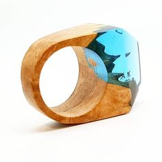 Wood and resin ring we have made.  Available on ArtfulResin.etsy.com  Love the…
