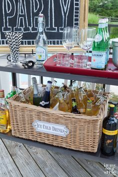 Great idea for a casual cooler. Wicker basket with plastic bin inserts.