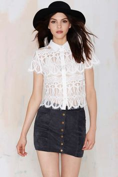 Jadina Lace Blouse is the perfect light-weight top for a chic summer day.