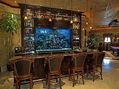fish tank display behind in-home bar