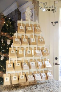 wood advent calendar - I think I would make green because I love color! And maybe make bags out of felt so the can be used each year!