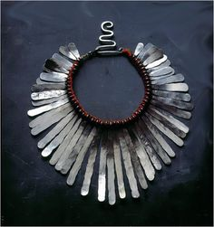 Alexander Calder necklace made of silver wire, string, and ribbon, circa 1943.