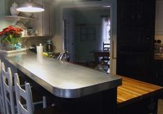 I am In Love with this galvanized steel countertop slip cover! Creative Little Daisy has me hooked!