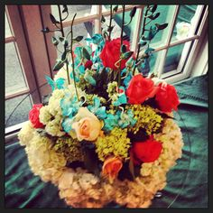 Here's an idea for colors to use in a springtime floral arrangement - the blue really sets this off