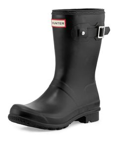 """Hunter Boot lightweight matte rubber rain boot can be rolled for easy packing. 1"""" flat heel; 10.8""""H shaft. Round toe. Decorative buckle strap at top. Logo patch at top center. Includes drawstring bag."""