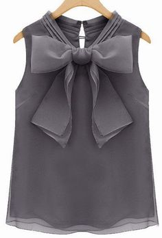 Grey organza blouse with a chic oversized bow. Capris. Check.