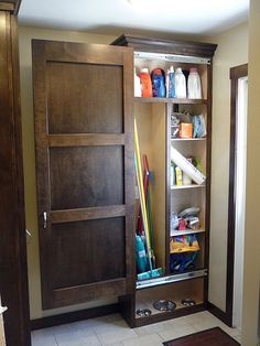 Custom made utility closet...with a sliding door, I want one.   Notice the place made for the dog dishes at the bottom.   I love this designer.....he's my husband.