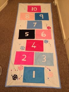Frozen gift hopscotch inspired by girl and a glue gun but my glue didn't stick so stitched instead.