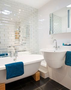 Modern Guest Bathroom with Mirrored-tile Wall