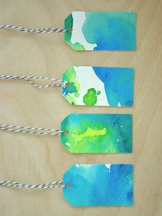 LOVE this cute and easy idea for watercolor gift tags! Could also do Christmas colors + red and white twine!