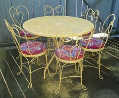Cool way of upholstering old iron dining chairs. I would paint them white. Love the ice cream parlor chair look though, especially if paired with a rustic wood table.